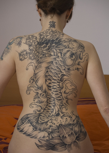 Koi fish tattoo meaning tattoosphoto in koi tattoos you will often combined them with water cherry blossom or lotus flowers however japanese koi tattoos have many symbolic meanings depending mightylinksfo